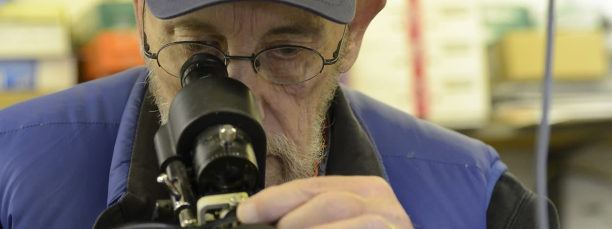 picture of lab tech inspecting lenses